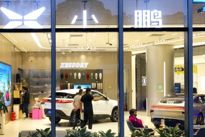 chinas-electric-carmakers-are-paying-top-dollar-to-snap-up-prime-storefronts-scaled.jpg