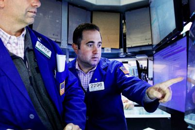 stock-futures-are-flat-ahead-of-major-earnings-reports-on-tuesday-scaled.jpg