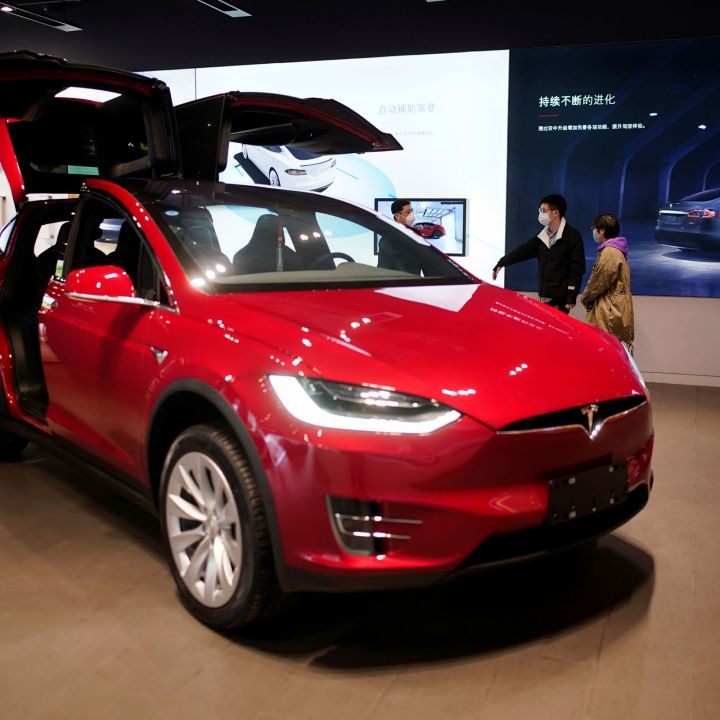 tesla-reports-earnings-this-afternoon-traders-share-whether-its-a-buy-here-scaled.jpg